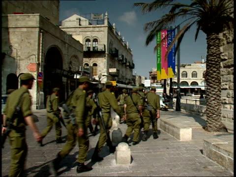 december 31 1966 zi troop of soldiers carrying weapons leisurely crossing and walking down the street / israel - israeli military stock videos & royalty-free footage