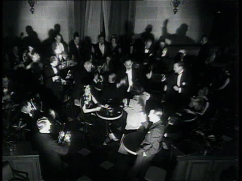 stockvideo's en b-roll-footage met december 6, 1933 montage people drinking, singing, and celebrating / new york city, new york, united states - 1933