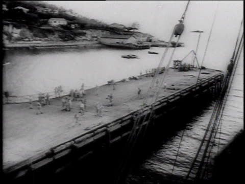 december 7 1941 montage navy ships being loaded and prepared for battle / pearl harbor hawaii united states - anno 1941 video stock e b–roll