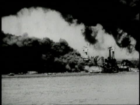 December 7 1941 MONTAGE the Battleship Arizona smoking and burning / Pearl Harbor Hawaii United States