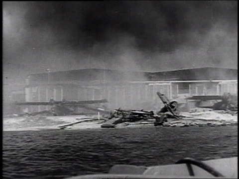 december 7 1941 pan smoking ruins of the naval base / pearl harbor hawaii united states - anno 1941 video stock e b–roll