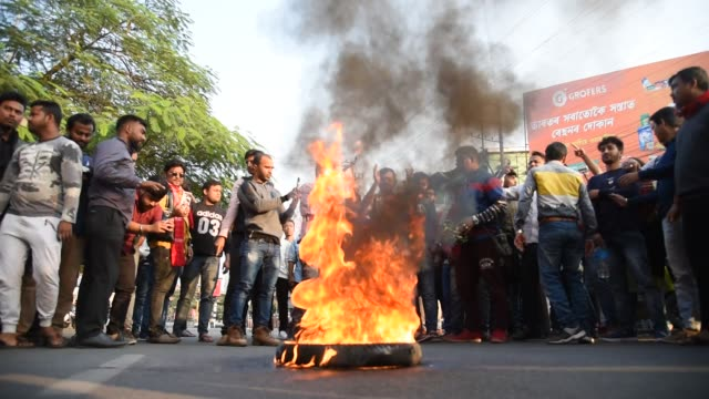 december. protesters shout slogans as they burn tyres on a road during the strike called by north east students' organization against the... - citizenship stock videos & royalty-free footage