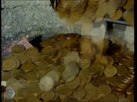 30th anniversary lib tms old imperial coins being poured into container to be melted down graphic showing new coins ms women queuing at checkout in... - checkout stock videos & royalty-free footage