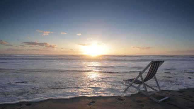 deck chair on the beach at sunset - deck chair stock videos & royalty-free footage