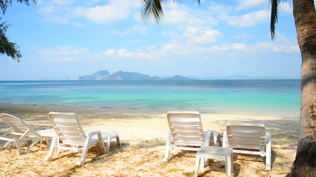 deck chairs on paradise island beach in summer season - beach chairs stock videos & royalty-free footage