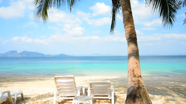 deck chairs on paradise island beach in summer season - deckchair stock videos & royalty-free footage
