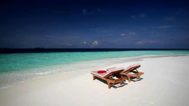 deck chairs on tropical beach, maldives, indian ocean - deck chair stock videos & royalty-free footage