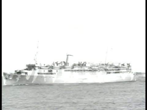 stockvideo's en b-roll-footage met convoy of ships on ocean ws us transport ship silhouette of us soldier on deck of ship two us soldiers looking overboard ws silhouette of us... - 1943