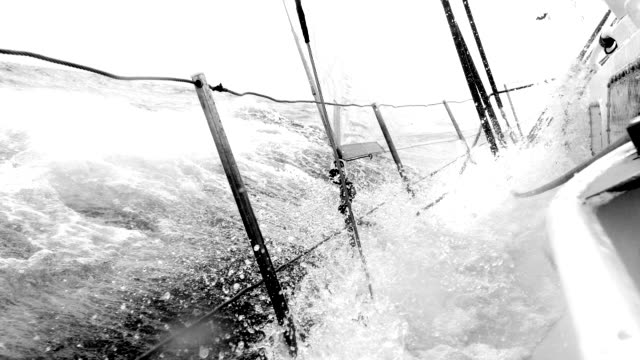 Deck of a yacht under water during a race under sail
