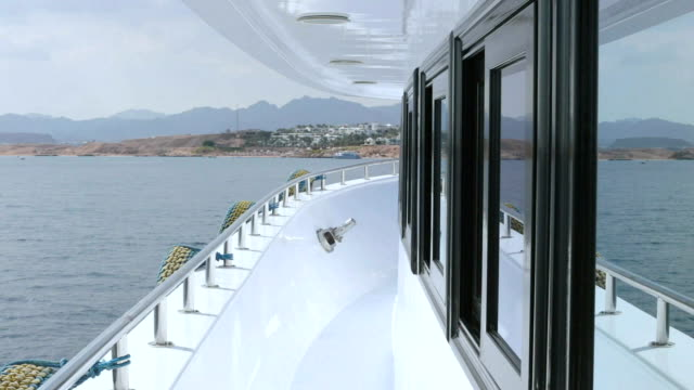 deck of a yacht with windows. - terrazza in legno video stock e b–roll