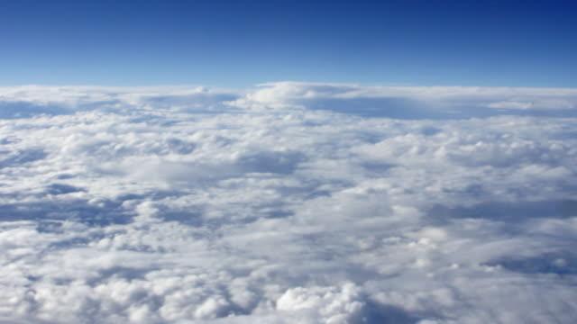 AERIAL Deck of clouds in blue sky