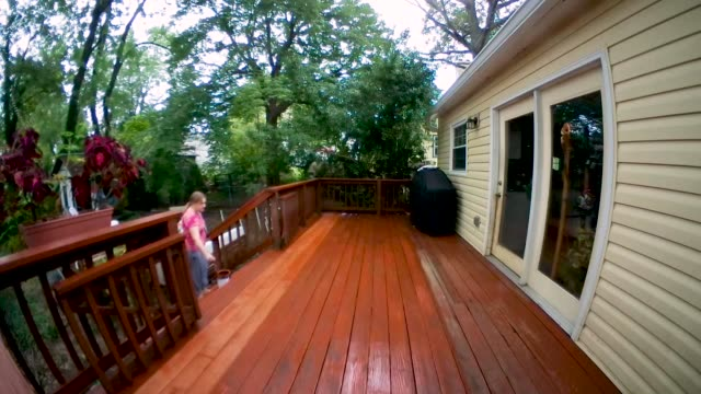 deck staining and sealing home improvement project time lapse - wood stain stock videos & royalty-free footage