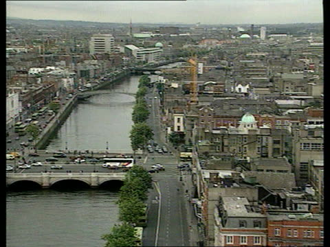 declare ceasefire: eire and northern ireland; eire: dublin: tgv city of dublin with river liffey running through pull out irish flag flying next... - ceasefire stock videos & royalty-free footage