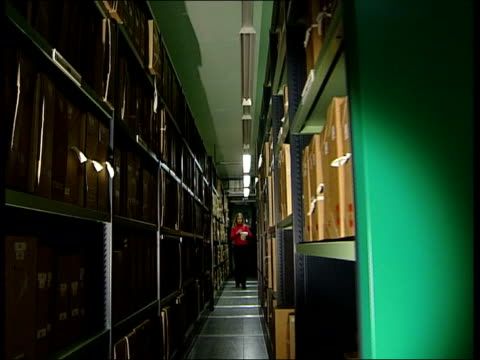 declassified government records released; channel 4 news: nicholas glass itn england: london: public records office: int woman removing boxes of... - paper stock videos & royalty-free footage