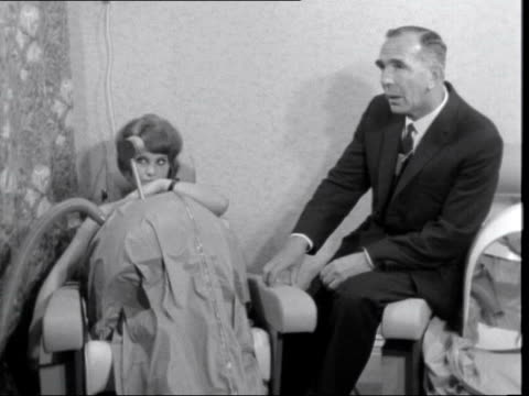 decompression clinic for expectant mothers; england: london: pont street: mum' in vacuum suit: tilt down legs:sof: heard: doctor giving instructions:... - anticipation stock videos & royalty-free footage