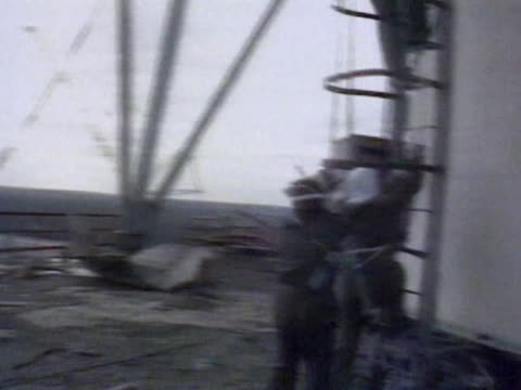 stockvideo's en b-roll-footage met / decontamination of the chernobyl site liquidators setting a red banner above the nuclear reactor - kernreactor