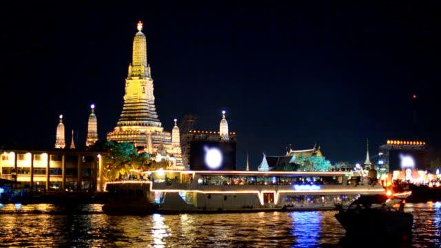 decorated boat in river behind Wat Arun, Bangkok, Thailand