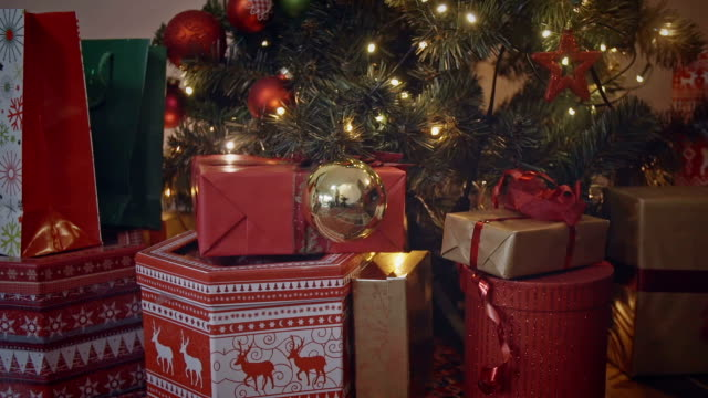 decorated christmas tree with presents - stockings stock videos & royalty-free footage