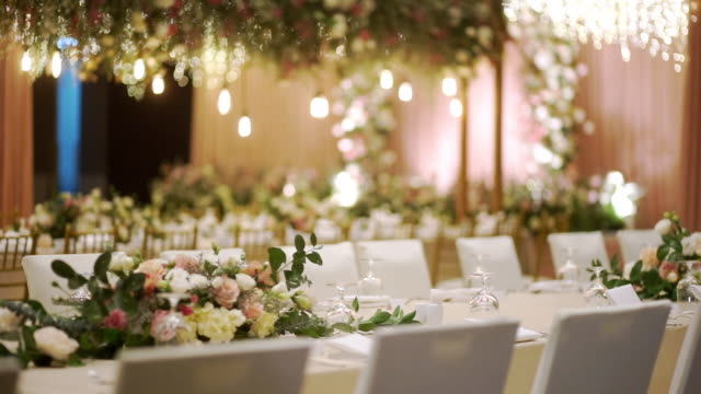 decorated dinner table with flowers for a large group of people at a wedding reception - table stock videos & royalty-free footage