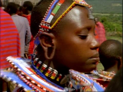 cu decorated masai tribeswoman performing ritual dance, kenya - masai stock videos and b-roll footage