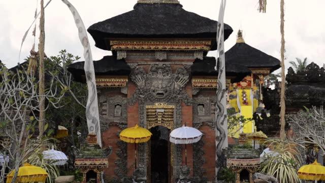 ms decorated pura dalem puri temple with colorful umbrellas / ubud, bali, indonesia - ubud district stock videos & royalty-free footage