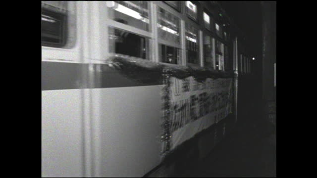 A decorated streetcar maneuvers along the Toden Ginza Line on its last day of operation in Japan.