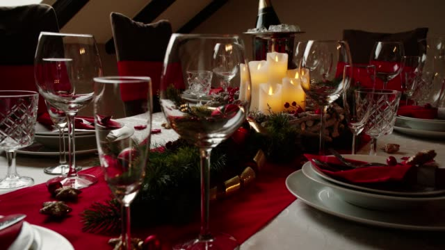 decorated table for christmas dinner with candles and christmas ornaments - place setting stock videos & royalty-free footage