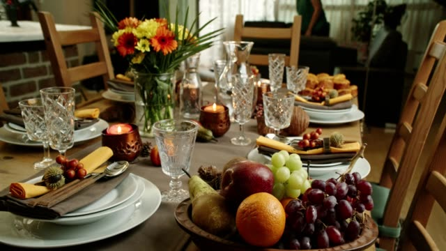 decorated table for thanksgiving dinner with candles, pumpkins, leafs and nuts - place setting stock videos & royalty-free footage