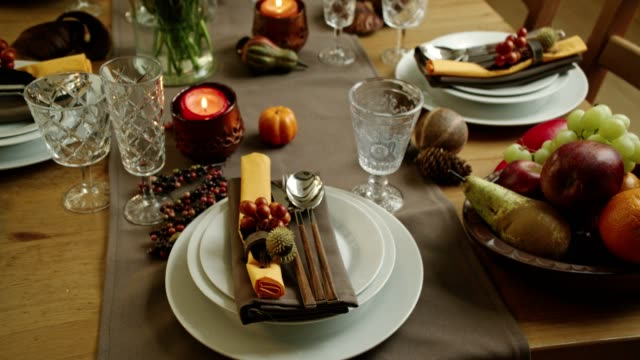 decorated table for thanksgiving dinner with candles, pumpkins, leafs and nuts - thanksgiving plate stock videos & royalty-free footage