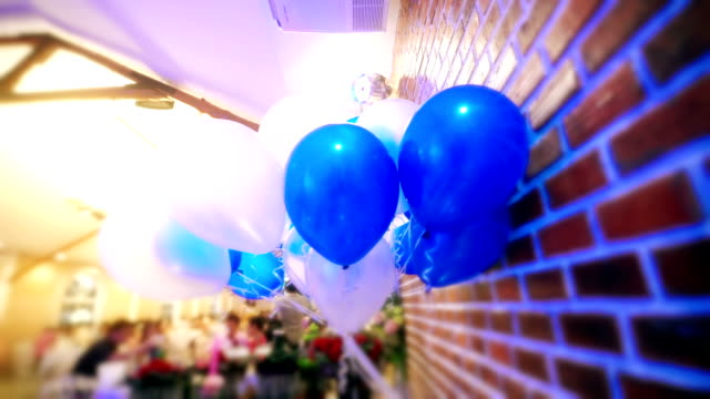 Decorated wedding ceremony with blue and white balloons.