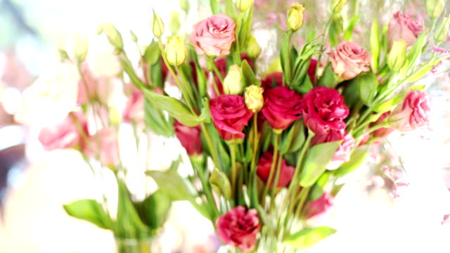 decorated wedding ceremony with pink and red flowers in vase on the table. - bunch of flowers stock videos & royalty-free footage
