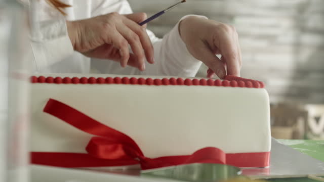 decorating a cake - decorating a cake stock videos and b-roll footage