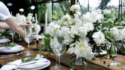 Decorating a festive table. Wedding table decoration with bouquets of Nnatural fresh flowers for a family feast