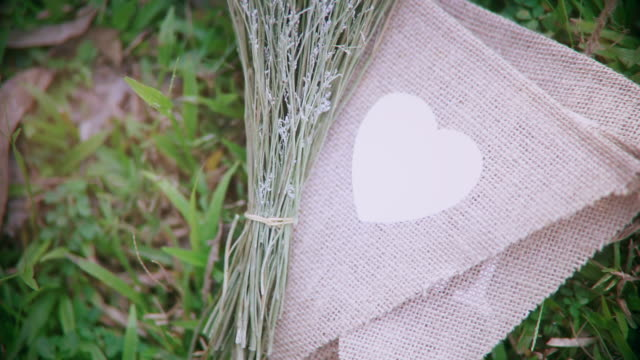 decorating a wedding with heart shapes on fabric. - hand on heart stock videos & royalty-free footage