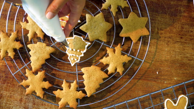 decorating christmas cookies with icing - baking stock videos & royalty-free footage