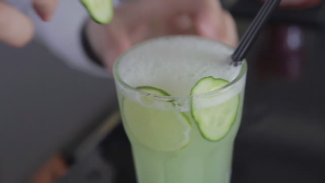 decorating cocktail close up shot - mixing stock videos & royalty-free footage