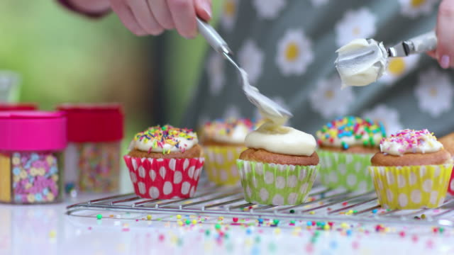 decorating cupcakes in kitchen - cupcake stock videos & royalty-free footage