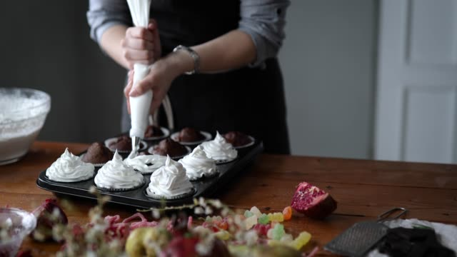 decorating delicious cupcakes - whipped cream stock videos and b-roll footage