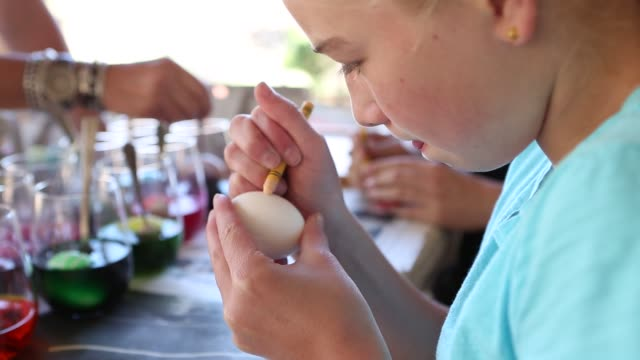 decorating easter eggs on table