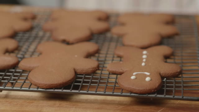 decorating gingerman bread - public celebratory event stock videos & royalty-free footage