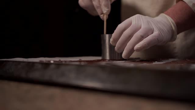 decorating on baking sheet - baking sheet stock videos & royalty-free footage