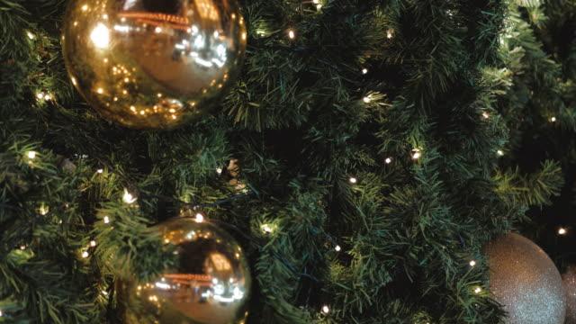 vídeos de stock e filmes b-roll de decorating the christmas tree magic christmas festival concept. - abeto