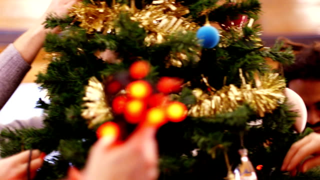 decorating the christmas tree takes teamwork - decoration stock videos & royalty-free footage