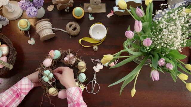 decorating wreath with eggs for easter - wreath stock videos & royalty-free footage