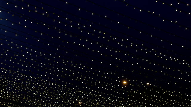 decoration string lights at night - fairy lights stock videos & royalty-free footage