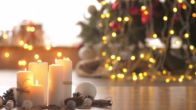 decorative arrangement for a nice christmas day - christmas decore candle stock videos & royalty-free footage