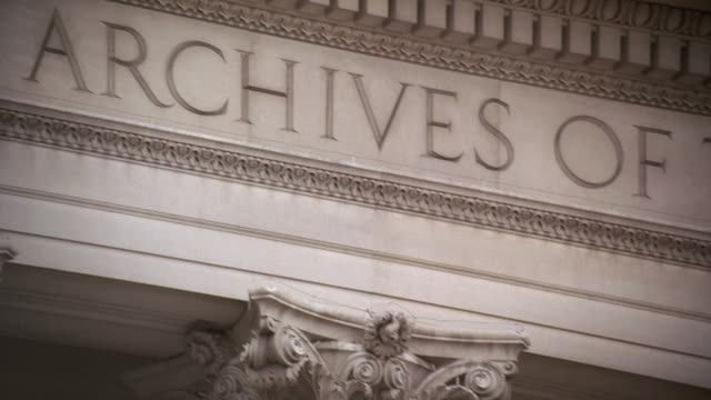 pan decorative capitals atop columns of the national archives building / washington, d.c., united states - national archives washington dc stock videos and b-roll footage