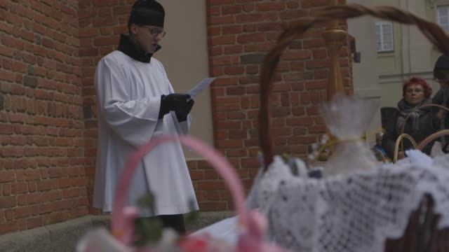 decorative easter baskets are blessed in warsaw's old town - religious dress stock videos & royalty-free footage