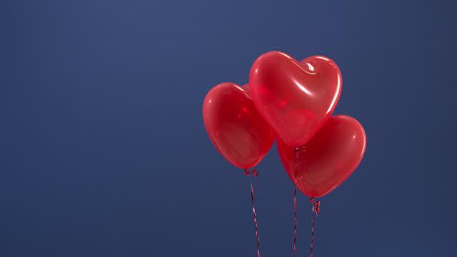 vidéos et rushes de cadeau d'élément décoratif pour la saint valentin, noël, anniversaire, ballon rouge en forme de coeur sur la clé de chroma. - illustration
