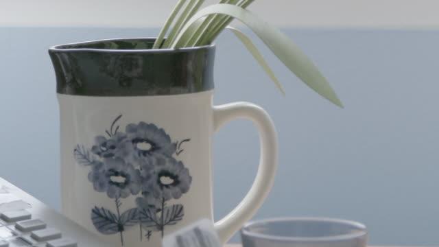 Decorative fake tulips in mug, close up